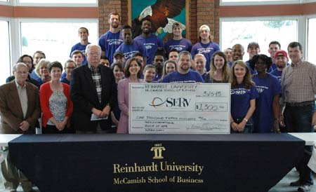 Two Reinhardt business classes presented more than $1300 to SERV International.
